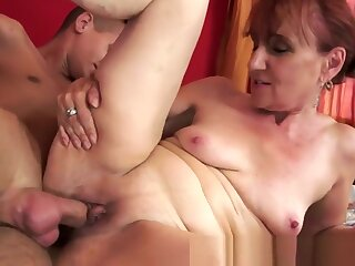 Redhead granny rides hard younger dick