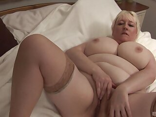Busty of age blonde amateurish gets naked and plays with her cunt