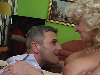 Matura beauteous loves when her follower groupie licks added to sucks on her tits