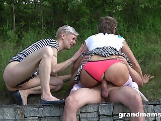 Public amateur lovemaking round two matures and a young cock