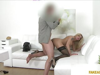 Fake-chested MILF shows wide to an agent's office hoping to wow him