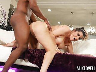 Black man picks up Alix Lovell during a hardcore bang session